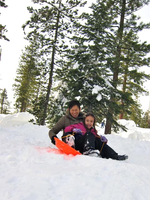 Kyoko and Kana sledding